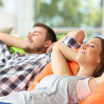 couple relaxing on environmentally friendly furniture