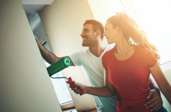 couple undergoing eco-friendly painting project