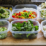 chopped vegetables in meal prep Tupperware to reduce food waste