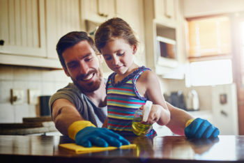 father and daughter cleaning the tabletops with eco-friendly household cleaners