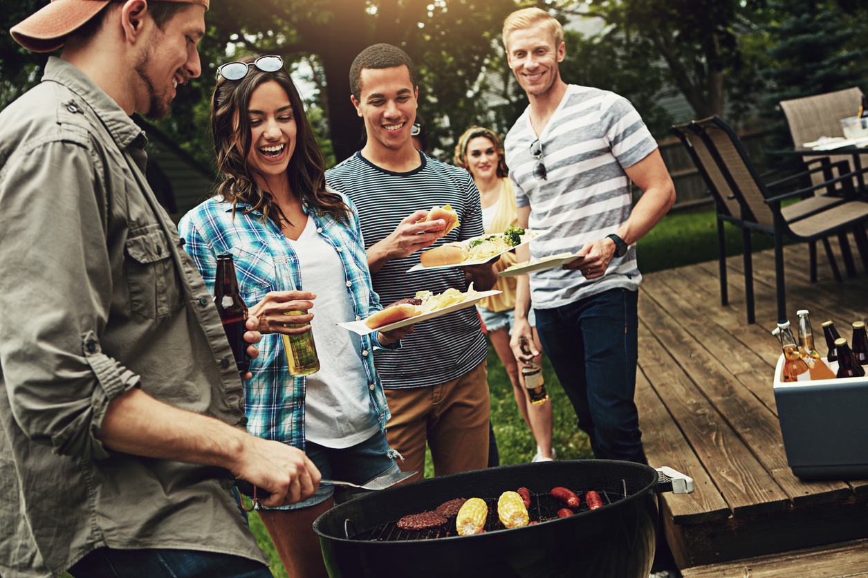 Shot of a group of friends having a barbecue in the yard