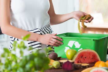 woman composting in her apartment. How to Compost in an Apartment