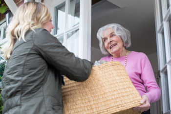 Younger woman borrowing from her neighbor in sharing community