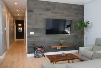 reclaim arbor wood paneling on the wall of an apartment