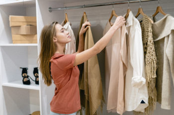 woman choosing clothes from her closet