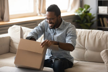 man opening a delivery box