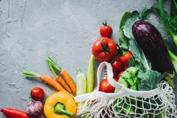 groceries in reusable bag | sustainable grocery shopping