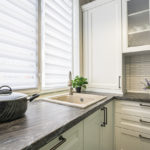 kitchen with open window blinds | how to conserve energy with windows